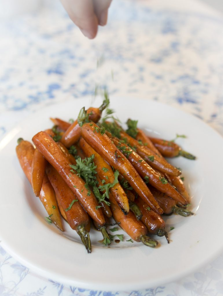 Sprinkling Parsley on Carrots