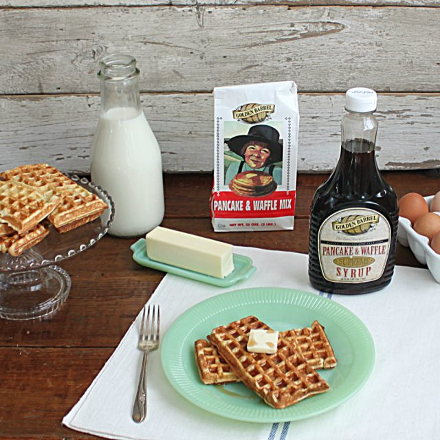 Waffles and Syrup on a Table