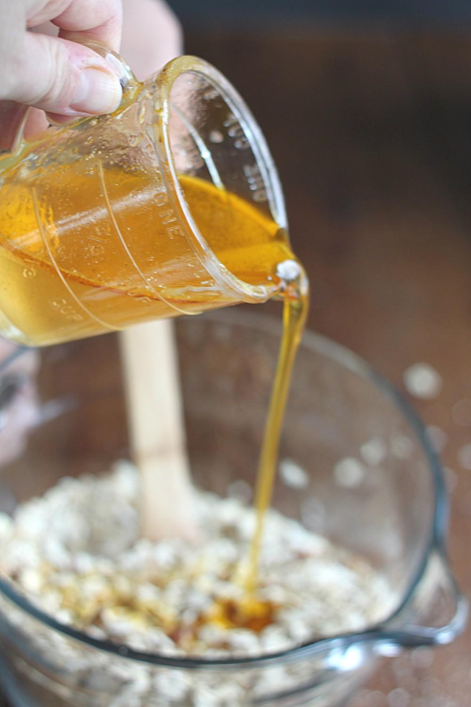 Pouring Oil to Make Homemade Granola
