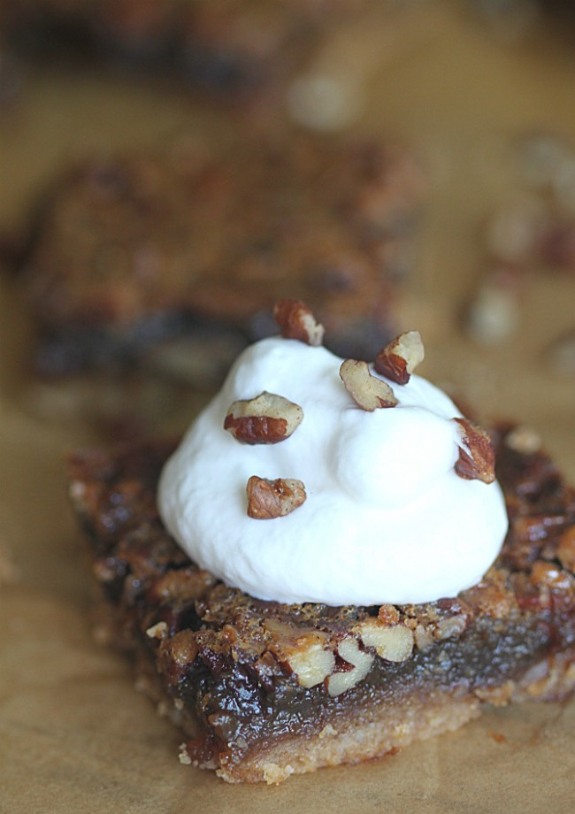 Pecan Bars with Whipped Cream on Top