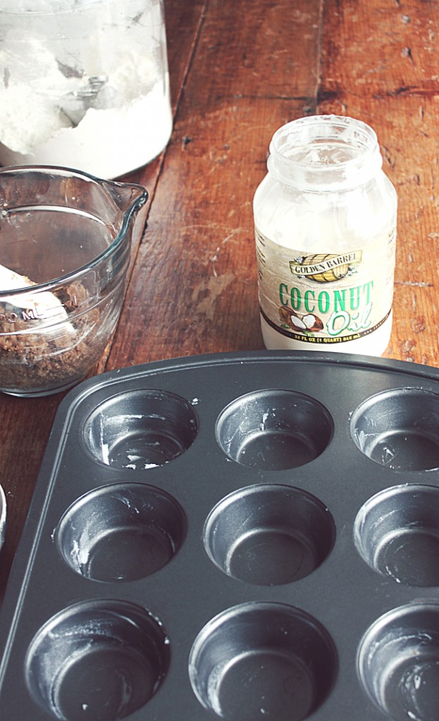 Greasing a muffin pan with Golden Barrel Coconut Oil