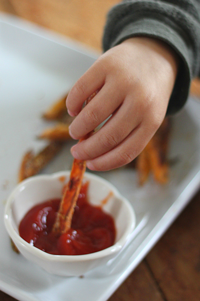 Dipping Sweet Potato Fries in Ketchup