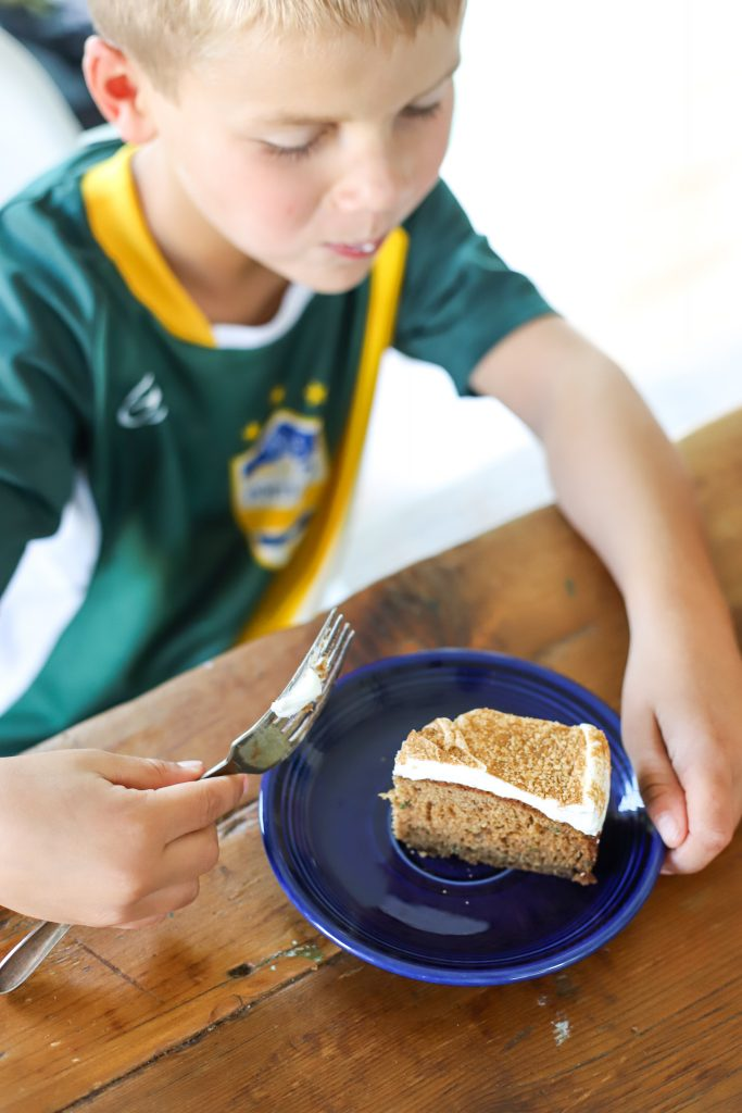Boy eating Brown Sugar Cinnamon Zucchini Cake